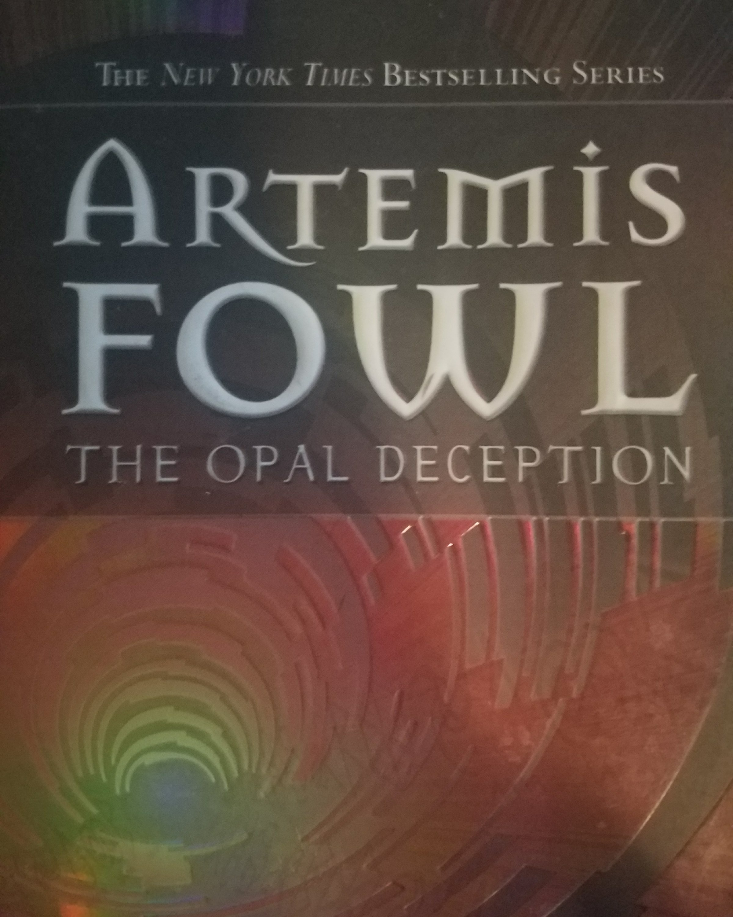 theme of artemis fowl the opal